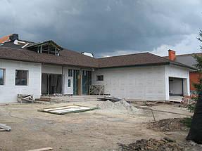 Облицовка травертином фасада частного дома 6