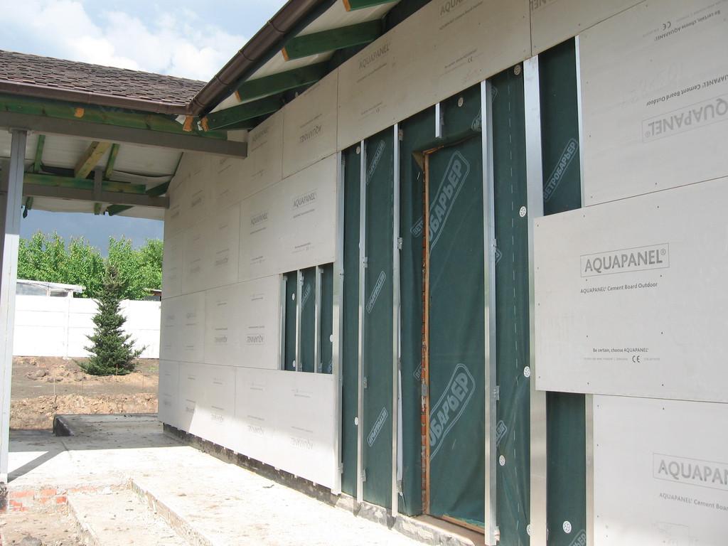Облицовка травертином фасада частного дома 9