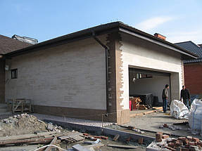 Облицовка травертином фасада частного дома 17