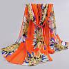 Шифоновый оранжевый шарф с цветами