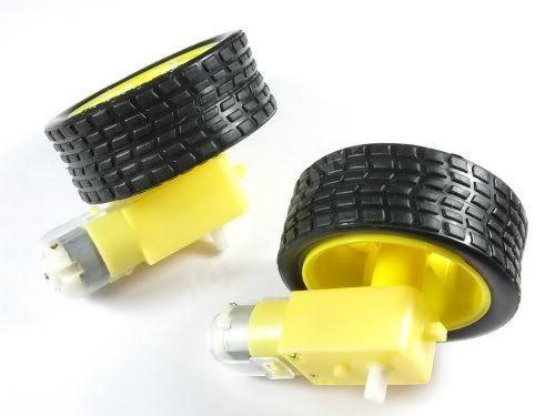 Электрический мотор с редуктором и колесом