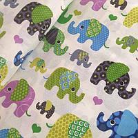 Ткань с слонами салатового цвета