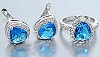 """Набор  """"серьги и кольцо"""",покрытие родием. Камень:белый и бирюзовый циркон. Высота серьги: 1,5 см Ширина: 13 мм"""