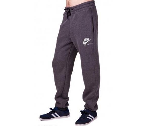 Спортивные штаны с логотипом Найк (Nike) мужские трикотажные темно серые на резинке внизу(манжет)Украина