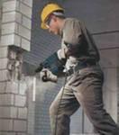 Демонтаж кирпичной стены