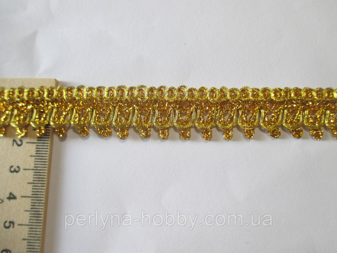 Тасьма декоративна люрекс золото зубчики 1.8-2 см см