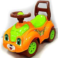 Детская каталка толокар оранжевая