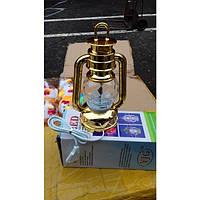 Лампа - светильник, крутится и светит от сети 220 В.