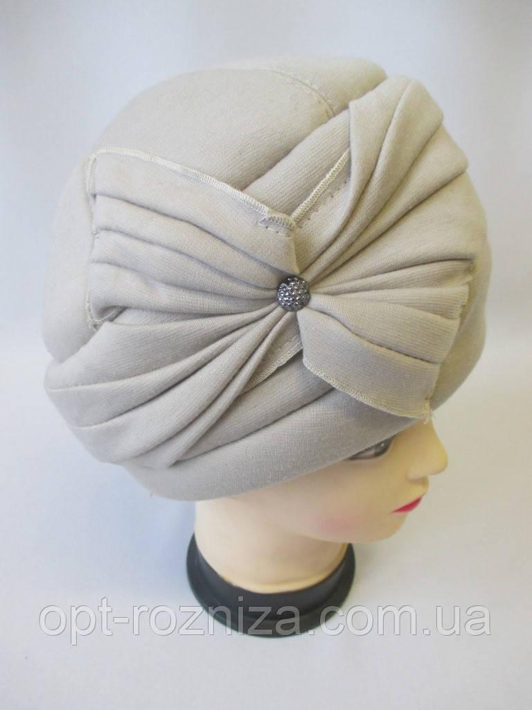 Утеплені жіночі шапки на зиму.