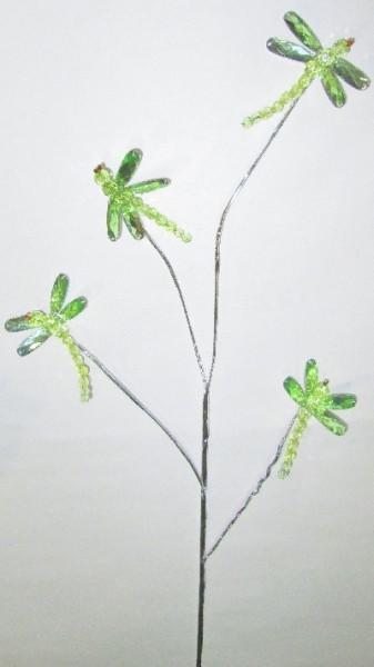 Стрекозы на ветке зеленые