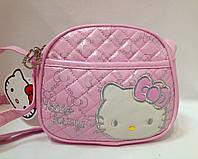 Сумка детская Hello Kitty полукруглой формы с наружным карманом и ремешком через плечо розовая