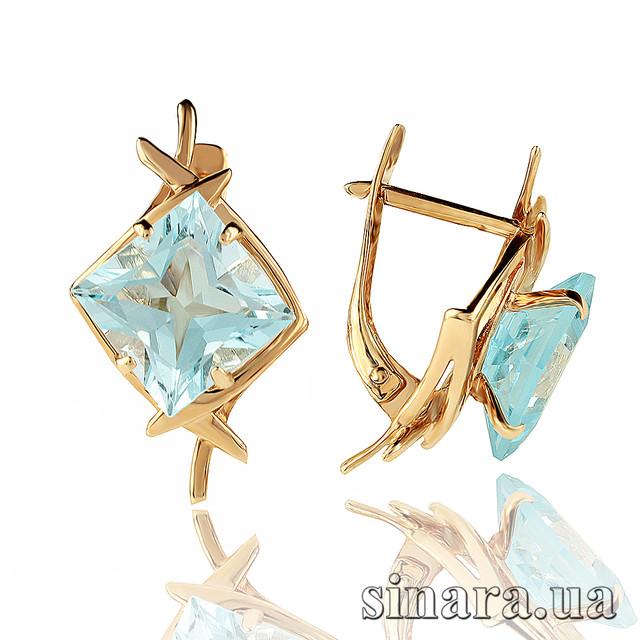 Золотые серьги с голубым топазом фото