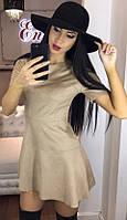 Ультрамодное женское платье приталенного фасона с расклешенным низом и коротким рукавом эко кожа