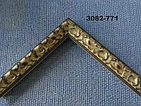 Багет деревянный темно-коричневого цвета, с лепниной окислившееся золото