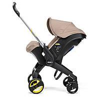 Doona - Детское автокресло-коляска, цвет бежевый
