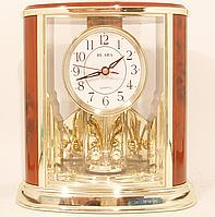 Часы настольные с вертушкой