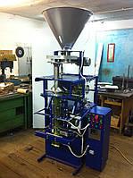 Фасовочно упаковочный автомат механический с объемным дозатором.