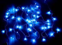 Электрическая гирлянда разноцветная/синяя 300L ROCKETS (лампочки в форме конуса)