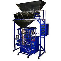 Фасовочно упаковочный автомат механический с четырьмя весовыми дозаторами.