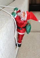 Новогодняя фигурка 20 см Санта Клаус лезет по лестнице