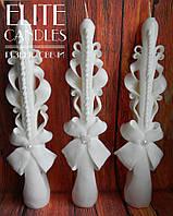 Набор тонких свадебных свечей белого цвета на свадьбу.