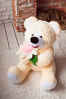 Плюшевый медведь персикового цвета Мишутка с ромашкой