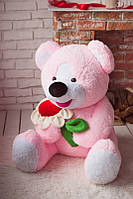 Розовый плюшевый медведь с ромашкой