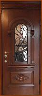 Дверь входная для улицы со стеклопакетом и ковкой.