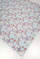Подарочная бумага (упаковочная) светлого бирюзового цвета с принтом единорожек