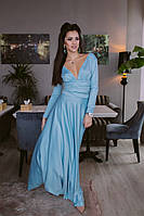 Шикарное однотонное платье в пол с длинным рукавом и откровенным декольте голубое