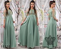 Нежное праздничное платье в пол с расклешенной шелковой юбкой зеленое