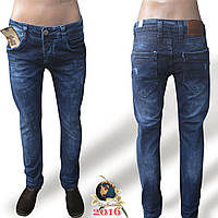 Джинсы мужские зауженные молодёжные синего цвета с потёртостями Турция.