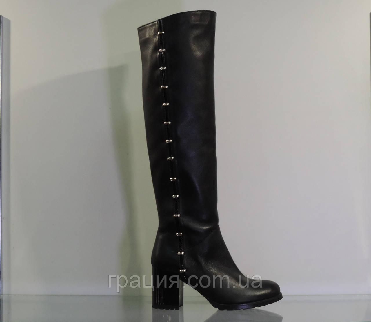Зимові жіночі шкіряні чобітки на середньому каблуці