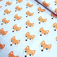 Бязь с мордочками лисичек оранжевого цвета № 133