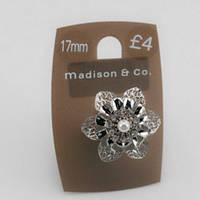 Стильное женское кольцо серебренного цвета в форме цветка