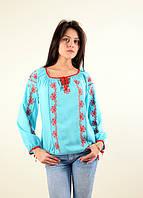 Яркая блуза из штапеля рукава и спереди расшита красным орнаментом