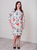 Нарядное женское платье из костюмной ткани с красивым рисунком