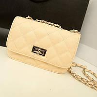 Женская сумка клатч Chanel бежевого цвета