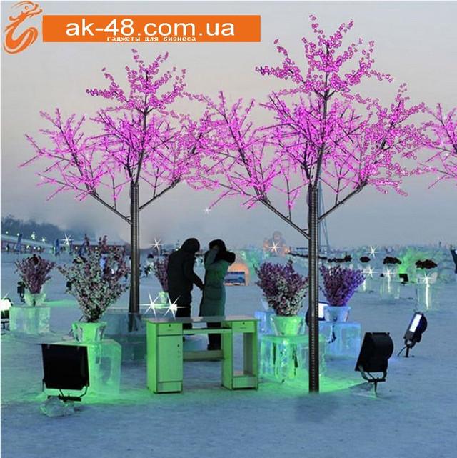 светящиеся деревья зимой.