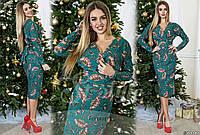 Элегантное платье приталенного силуэта с вшивным поясом, декорированное оригинальным цветочным принтом.