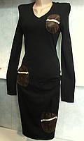 Женское платье черного цвета с кожаными карманами