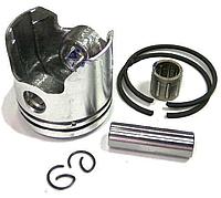 Поршень бензотриммера с диаметром 36 мм.