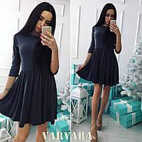 Расклешенное платье из трикотажа