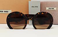 Солнцезащитные очки Miu Miu SMU 070 Q Коричневый лео