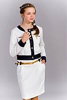 Современный подростковый костюм ― жакет и юбка.