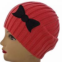Розовая женская зимняя шапка с бантом