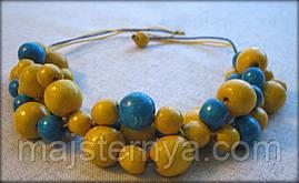 """Коралі """"Гроно Щастя"""" жовто блакитні, з дерева, покриті лаком."""