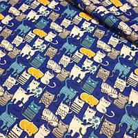 Хлопковая ткань с котиками желтого,серого цвета на синем фоне №367