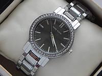 Женские кварцевые наручные часы Anne Klein стального цвета с черным циферблатом