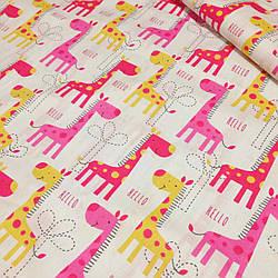 Хлопковая ткань с желтыми,розовыми жирафами на белом фоне  №37